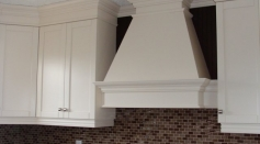 Transitional Kitchen coloured lacquer wood hood